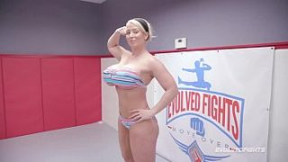 Huge tits MILF Alura Jenson naked wrestling kicks balls of her whimpy opponent at Evolved Fights